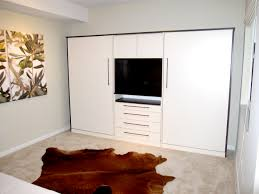 Small Bedroom Tv Ideas Bedroom Animal Skin Rug Feat Two Modern White Murphy Beds With