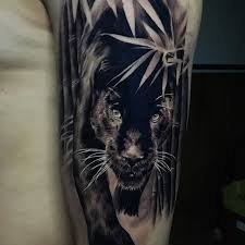 black and grey panther tattoo on arm sleeve