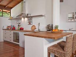 kitchen wooden floors and bench top simple white cupboards no