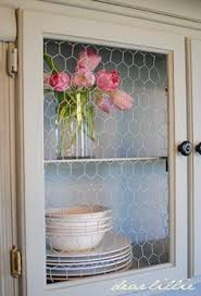 Chicken Wire Cabinet Doors Distressing With Vaseline And Cabinet Scrapers Distressed