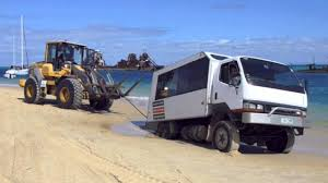 moreton island volvo l60f recovers bogged canter tour 4wd bus