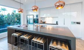 kitchen golden pendant lamp with modern sink and large