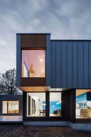 house in canada combines steel and wood panelling