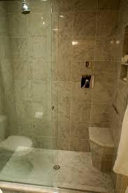 rectangle glazed shower areas with steel rain head shower on grey