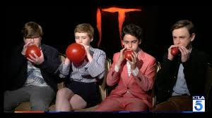 Film It | the stars of the film it race to blow up the iconic red balloon