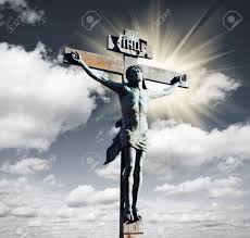 crucifixion of jesus christ in the sky and the sun stock photo