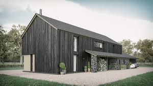 a barn style home featuring natural stone and finished with