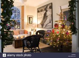 christmas tree and decorations in the living room of a georgian