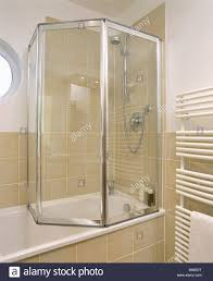 folding shower doors walk in shower with seamless glass folding folding glass shower doors on bath in modern bathroom with neutral wall tiles