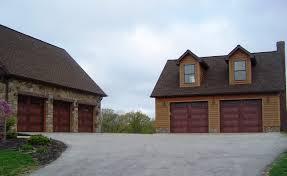 resource industries garage door shown is a carriage house garage door by c h i overhead doors