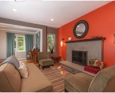 Tangerine Orange Living Room With White Furniture Love The Use Of - Living room paint design ideas