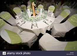 dining room table setting at wedding reception stock photo