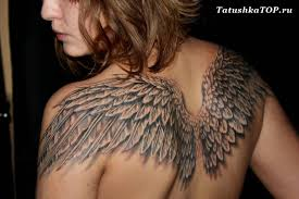 40 wings tattoos on back