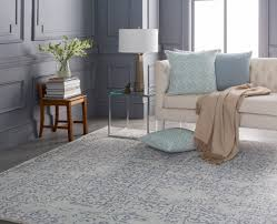 surya partners with elle to introduce rug and pillow collections