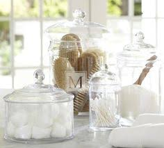 classic lidded clear glass canisters store and display dry goods