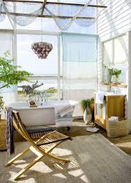 elegant outdoor bathroom with stone floor and folding glass door