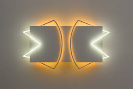 wall sculptures and neon lights by shinn retail design