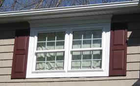 exterior natural brick siding and white exterior window trim