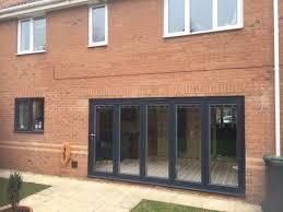 origin doors with blinds open living
