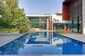 new delhi custom home in a lush setting with spacious courtyard
