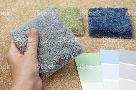 home decorating choosing carpet samples and paint colors stock