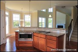 kitchen island with raised bar top 11 kitchen island layouts kitchen island ideas