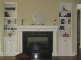 Cream Bookshelves by White Cement Fireplace Built In Shelves Also Brown Wooden