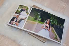 wedding photo album book pages of wedding photobook or wedding album at carpet on wooden