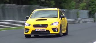 yellow subaru wrx subaru wrx sti prototype seen testing at the nurburgring
