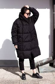how to keep warm in winter black oversize quilted coat i heart