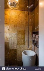 poder room powder room with gold ceramic tiles granite pedestal sink and