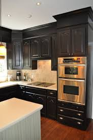 cool black color wooden kitchen corner cabinets featuring l shape