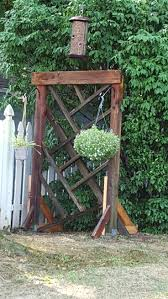 reclaimed wood garden trellis using the support posts from our old