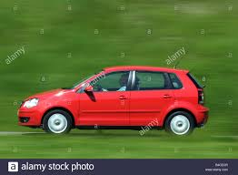 volkswagen red car car vw volkswagen polo 1 4 tdi model year 2005 red driving