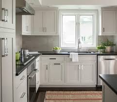 white kitchen cabinets with black quartz chic kitchen features light gray cabinets paired with