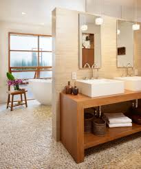 bathroom gorgeous pebbles stone wall decor over wooden sink with