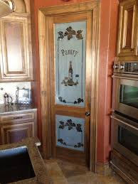 inward pantry glass door with white wooden frame interior