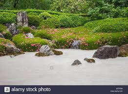 the karesansui zen garden of raked sand rocks and plants at stock