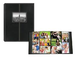 photo album pages 4x6 holds 300 photos 5 up with black background it is post bound so
