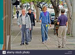Blind People Canes Accompanied By An Instructor A Blind Man Using A White Cane