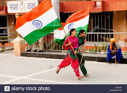 Ceremony Flag Two Girls Running Waving The Indian Flag At A Border Ceremony In