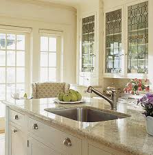 In This Soft Cream Kitchen The Upper Cabinets Showcase Decorative - Leaded glass kitchen cabinets