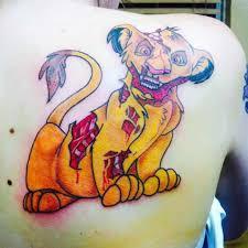 wild simba tattoo cartoon back tattoo on tattoochief com