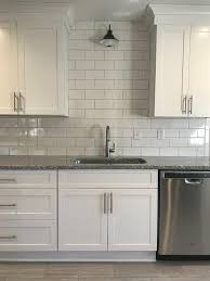 white kitchen cabinets with light grey backsplash white kitchen cabinets with this white subway tile and