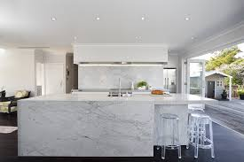 carrara marble kitchen island carrara marble flows the top and three sides of the