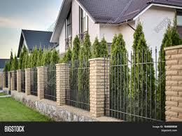 metal fence brick columns on image u0026 photo bigstock