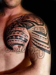 collection of 25 outline polynesian tattoos on chest and shoulder