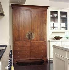 refrigerator that looks like a cabinet fridge that looks like furniture fantasy fridge looks like vintage