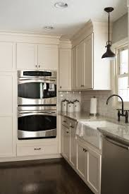 small white kitchen with stainless steel appliances u2022 kitchen