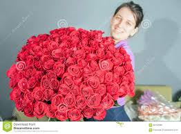 big bouquet of roses florist woman prepares a big bouquet of roses stock photo